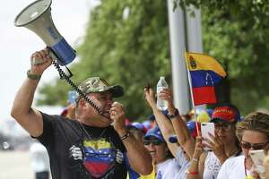 "Jose Criollo, 61, leads a chant in protest of current president Nicolás Maduro Tuesday, April 30, 2019, in Houston. Venezuelans in Houston assembled to support Juan Guaidó, Venezuela's opposition leader, who declared on Tuesday that they are ""beginning the final phase of Operation Freedom."" Guaidó called for a march inside Venezuela and abroad for May 1st, but that was changed for today once Leopoldo Lopez, an opposition leader, was released from prison."