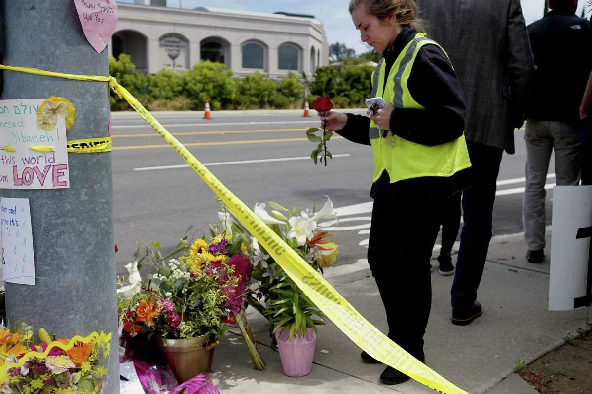 Mourners and well wishers leave flowers and signs at a make-shift memorial across the street from the Chabad of Poway Synagogue on Sunday, April 28, 2019 in Poway, California, one day after a teenage gunman opened fire, killing one person and injuring three others including the rabbi as worshippers marked the final day of Passover, authorities said. - The shooting in the town of Poway, north of San Diego, came exactly six months after a white supremacist killed 11 people at Pittsburgh's Tree of Life synagogue -- the deadliest attack on the Jewish community in US history. (Photo by SANDY HUFFAKER / AFP)SANDY HUFFAKER/AFP/Getty Images