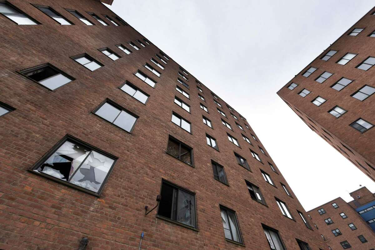 Broken windows are prevalent in buildings 1 and 2 in the John P. Taylor Apartments complex on Monday, April 29, 2019, in Troy, N.Y. There are four public housing units on the Troy riverfront complex. Buildings 1 and 2 have been unoccupied for some time. Numbers 3 and 4 are still in use. (Will Waldron/Times Union)