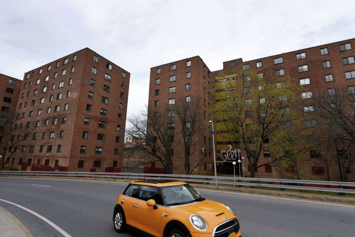 Exterior of buildings 1 and 2 in the John P. Taylor Apartments complex on Monday, April 29, 2019, in Troy, N.Y. There are four public housing units on the Troy riverfront complex. Buildings 1 and 2 have been unoccupied for some time. Numbers 3 and 4 are still in use. (Will Waldron/Times Union)