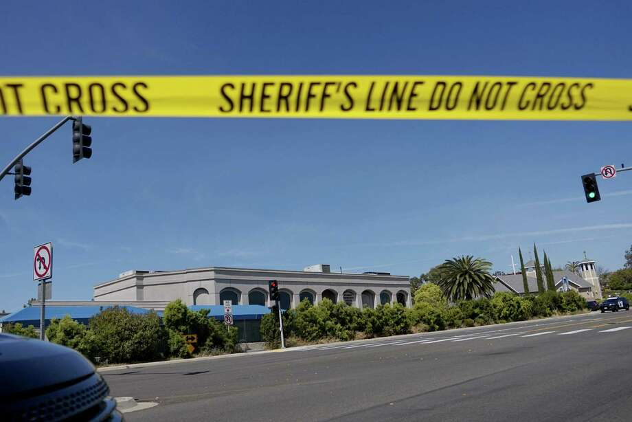 TOPSHOT - Sheriff's crime scene tape is placed in front of the Chabad of Poway Synagogue after a shooting on Saturday, April 27, 2019 in Poway, California. - A gunman opened fire at a synagogue in California, killing one person and injuring three others including the rabbi as worshippers marked the final day of Passover, officials said Saturday, April 27, 2019. The shooting in the town of Poway came exactly six months after a white supremacist shot dead 11 people at Pittsburgh's Tree of Life synagogue -- the deadliest attack on the Jewish community in the history of the United States. (Photo by SANDY HUFFAKER / AFP)SANDY HUFFAKER/AFP/Getty Images Photo: SANDY HUFFAKER / AFP/Getty Images / AFP or licensors