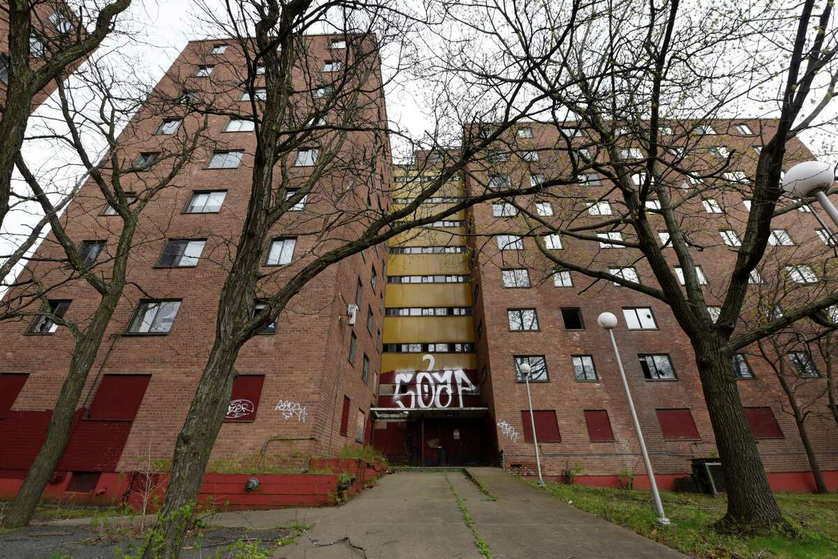 Exterior of building 2 in the John P. Taylor Apartments complex on Monday, April 29, 2019, in Troy, N.Y. There are four public housing units on the Troy riverfront complex. Buildings 1 and 2 have been unoccupied for some time. Numbers 3 and 4 are still in use. (Will Waldron/Times Union)