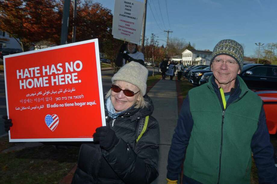 Nancy and Stefan Nagel participate in a march against hate and bigotry organized by Scott Milnor and Susan Cutler as it moves through Wilton Center from the Wilton Train Station Saturday, November 11, 2017, in Wilton, Conn. While their specific act of protest is a reaction to the anti-Semitic note found on a sixth-grader's locker at Middlebrook, Saturday's march is aimed at all acts of intolerance, bigotry and hate. Photo: Erik Trautmann / Hearst Connecticut Media / Norwalk Hour