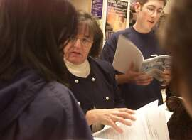 COLLEGE-01-C-23NOV99-CZ-MK  - Las Lomas High School College Career Advisor, Ellen Smith is mobbed by stressed out students concerned with quickly coming deadlines for college application. BY MIKE KEPKA/THE CHRONICLE