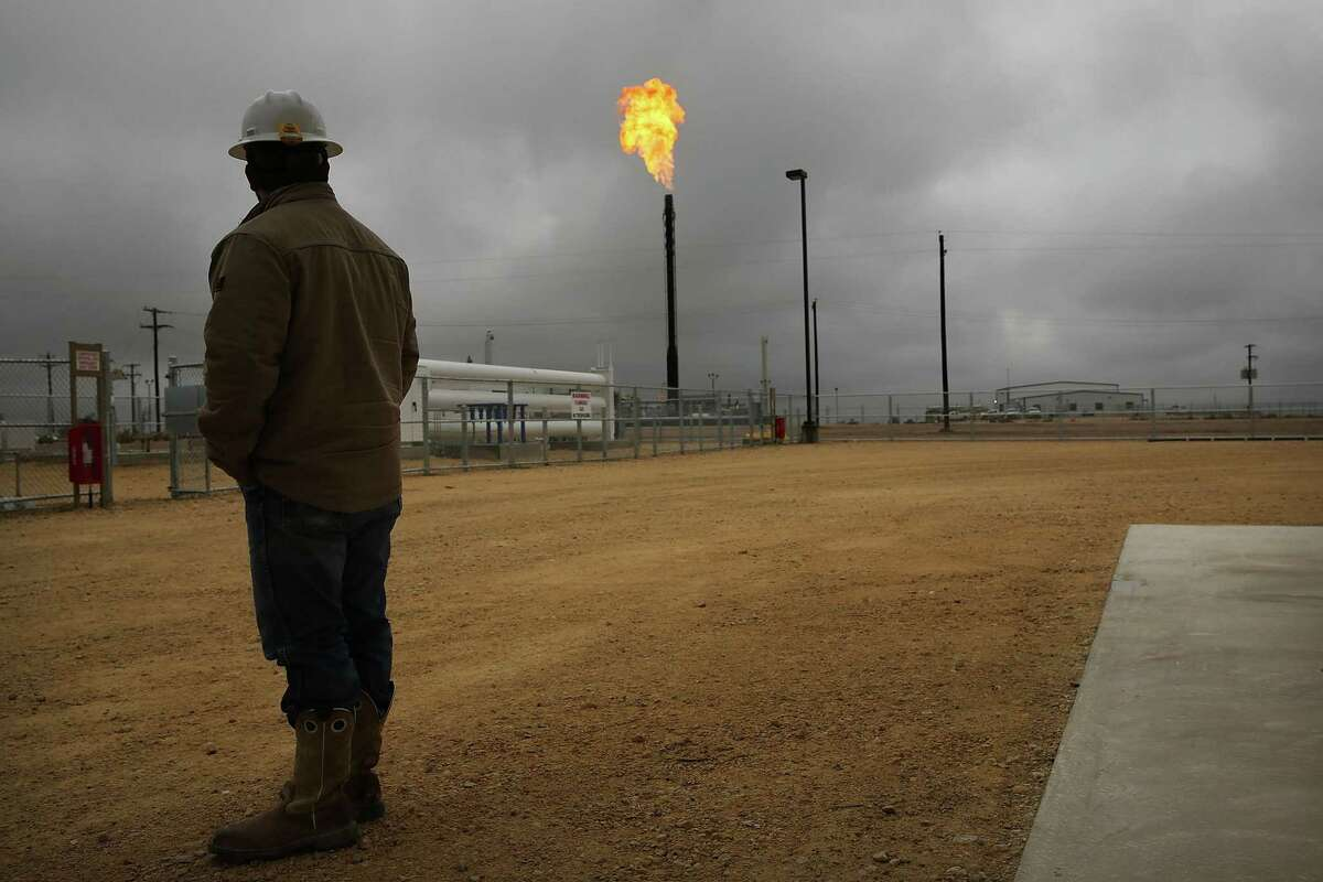 GARDEN CITY, TX - FEBRUARY 05: Flared natural gas is burned off at Apache Corporations operations at the Deadwood natural gas plant in the Permian Basin on February 5, 2015 in Garden City, Texas.