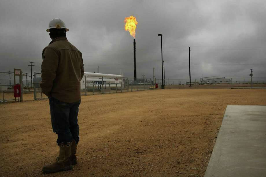 Houston oilfield service company Baker Hughes is using the Permian Basin of West Texas to debut a fleet of new turbines that use excess natural gas from a drilling site to power hydraulic fracturing equipment — reducing flaring, carbon dioxide emissions, people and equipment in remote locations. Photo: Spencer Platt, Staff / Getty Images / 2015 Getty Images