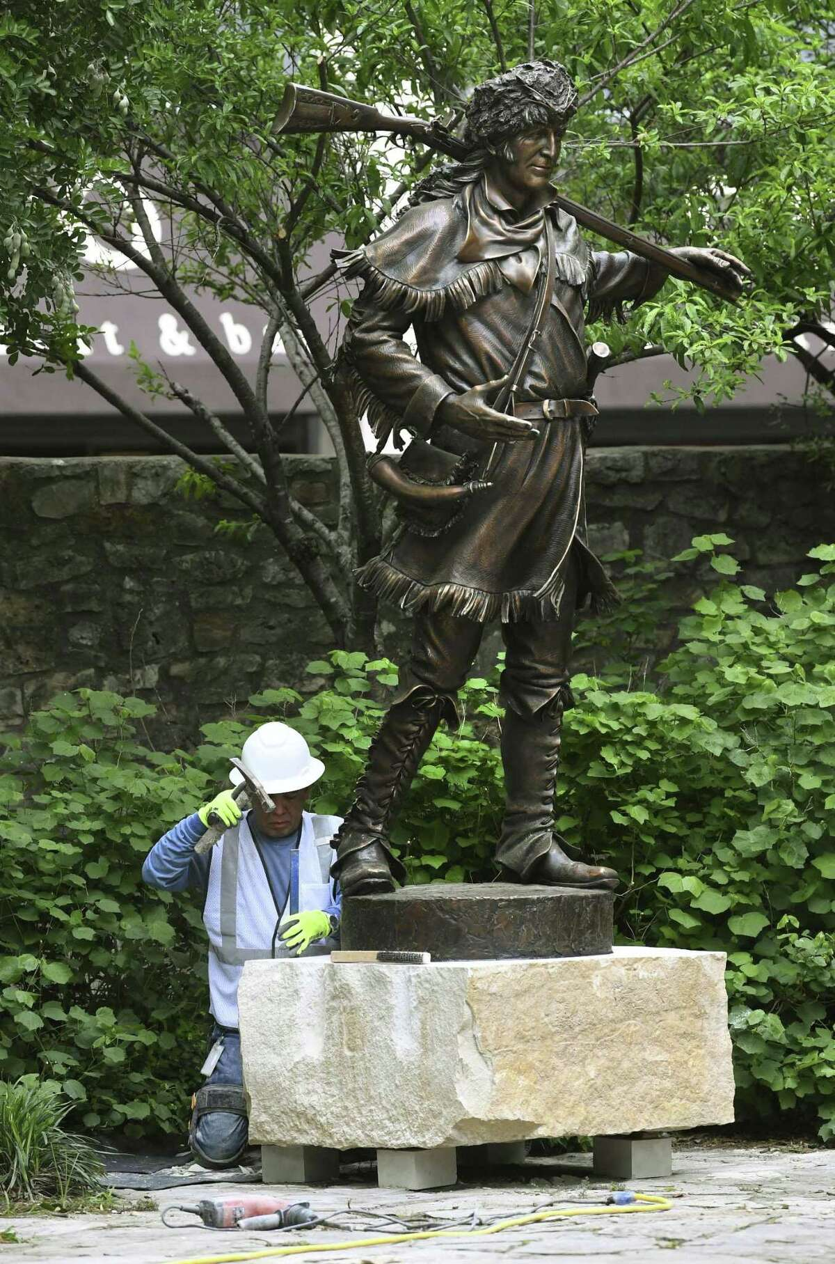 A statue of David Crockett, who fought at the 1836 Battle of the Alamo, is placed in Cavalry Courtyard on Tuesday, April 30, 2019. Bronze sculptures of historic Alamo personalities are being installed. They also include William Barret Travis, John William Smith, Susanna Dickinson, James Bowie and Jose Antonio Navarro.