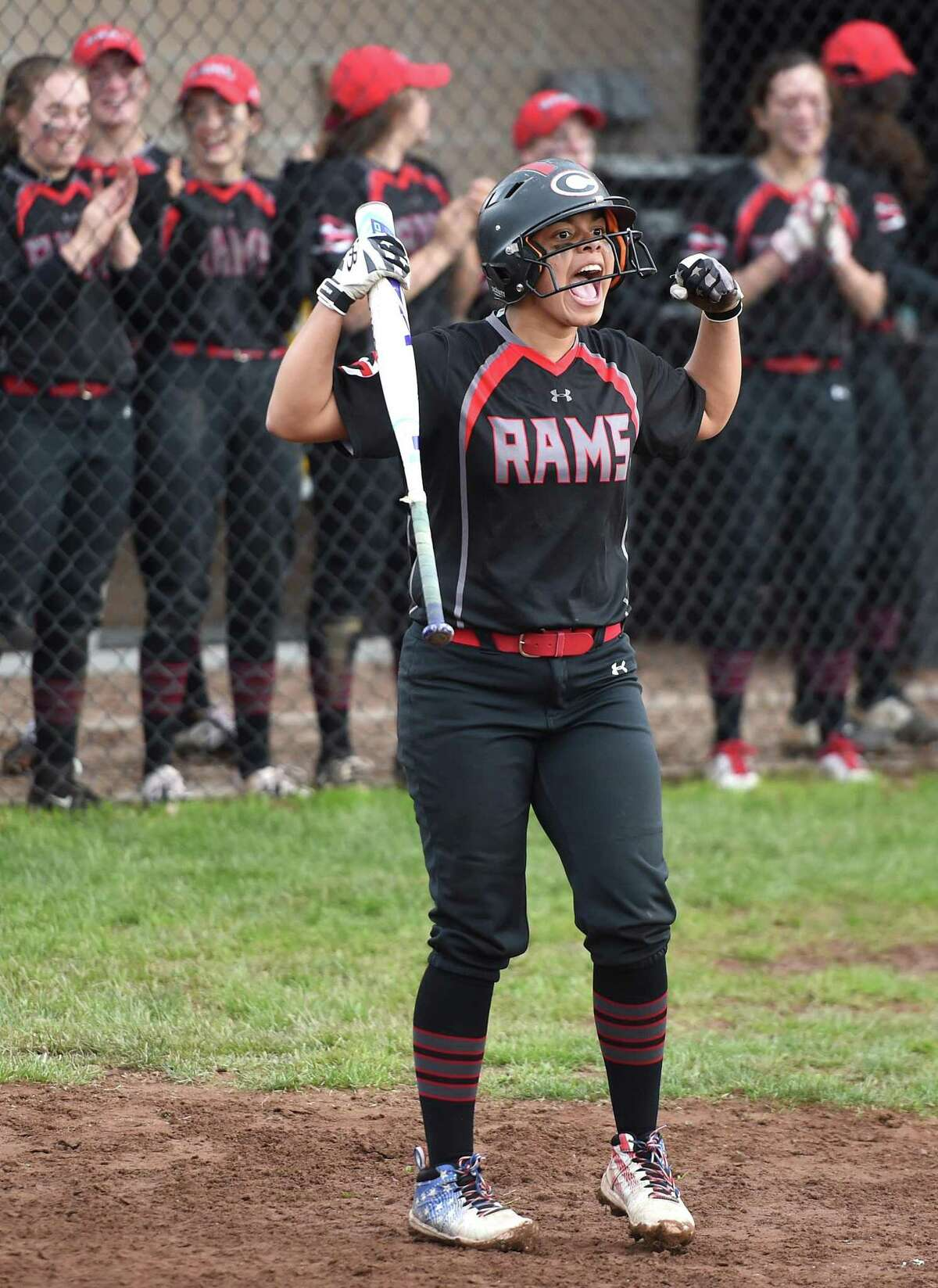 Cheshire's Jade Barnes celebrates as she comes to bat against Southington after Cheshire scored two runs in the seventh inning to tie the game at 3 on Tuesday.