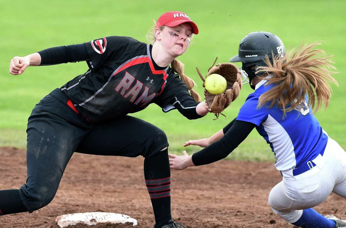 Cheshire's Mia Juodaitis, left, tagged out Southington's Kayla Pelletier after she slid past second base on an attempted steal in the fifth inning on Tuesday.