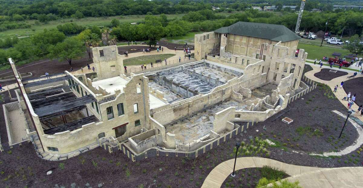 The former Hot Wells Hotel is seen Tuesday, April 30, 2019, during the grand opening of the Hot Wells of Bexar County park. The once-crumbling building has been stabilized by Bexar County as part of turning the approximately 4-acre site into a park which is connected to the Mission Reach section of the San Antonio River Walk.