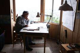 Architect George Homsey, of EHDD, works on a home renovation project for a friend in his home office on August 23, 2013 in the Dolores Heights area of San Francisco, Calif.