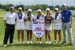 The Trinity girls golf team pose after its dominating victory at the TAPPS 4A state championship tournament at Waco's Cottonwood Creek Golf Course. From left to right, coach Kris Crow, Courtney Evans, Alexandra Escamilla, Aspen Escamilla, Brooke Widner, Jules Crow and head coach Neil Dufford.