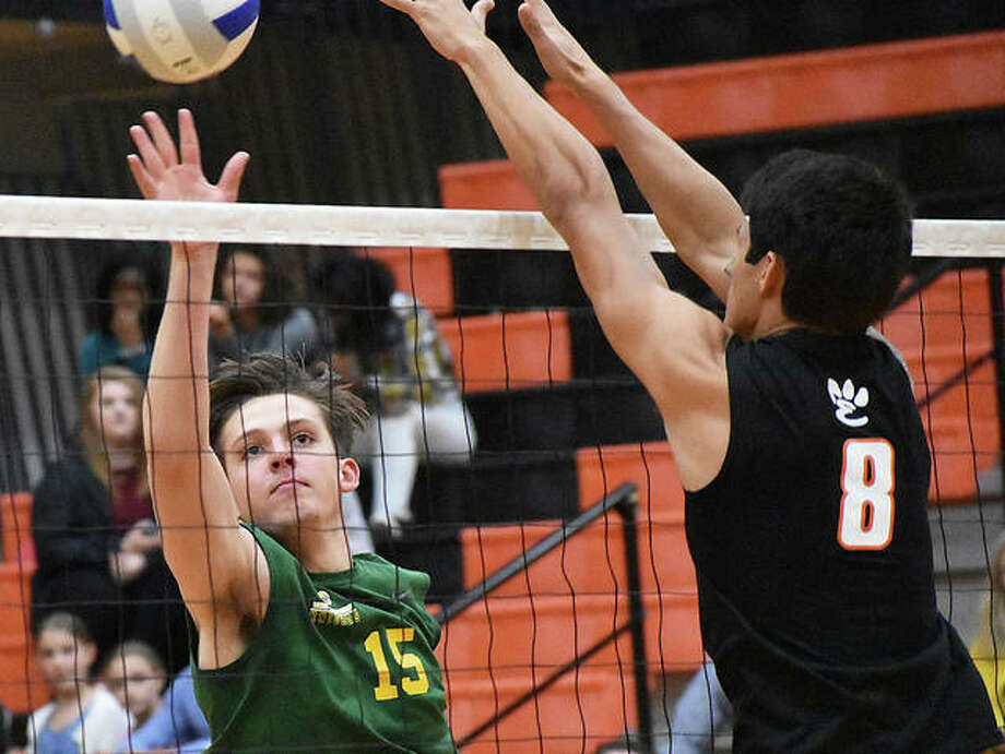 Metro-East Lutheran's Will Barney tries to hit around EHS blocker Eric Epenesa during the first game Tuesday. Photo: Matt Kamp/The Intelligencer