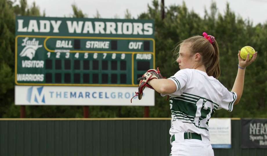 Gracie Graham #12 of The Woodlands Christian Academy warms up before a high school softball game, Tuesday, April 30, 2019, in The Woodlands. Photo: Jason Fochtman, Houston Chronicle / Staff Photographer / © 2019 Houston Chronicle