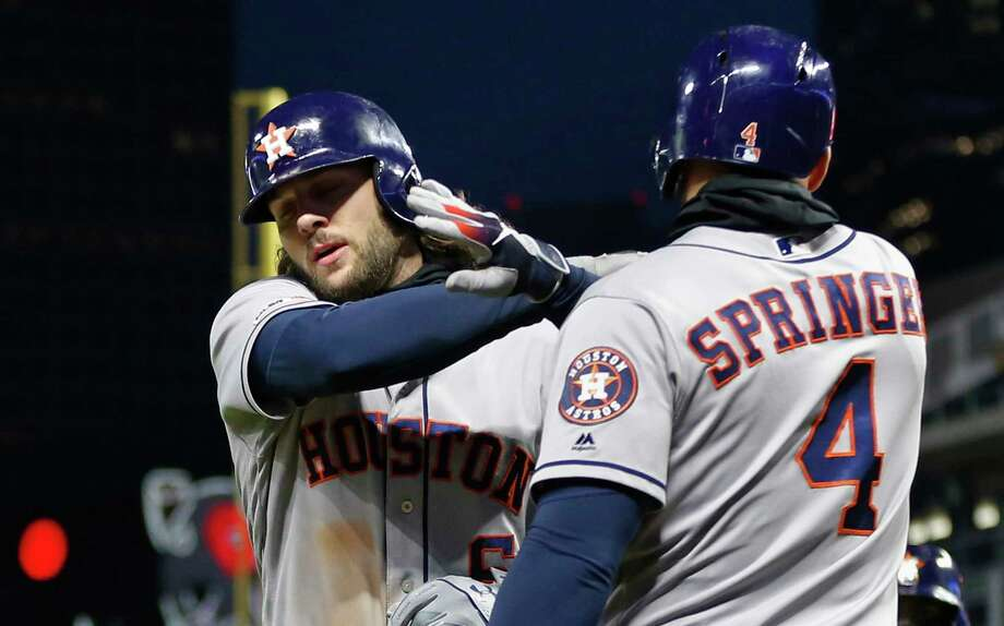 Houston Astros' Jake Marisnick, left, is congratulated by George Springer following his two-run home run off Minnesota Twins' pitcher Michael Pineda in the sixth inning of a baseball game Tuesday, April 30, 2019, in Minneapolis. (AP Photo/Jim Mone) Photo: Jim Mone, Associated Press / Copyright {2019} The Associated Press. All rights reserved