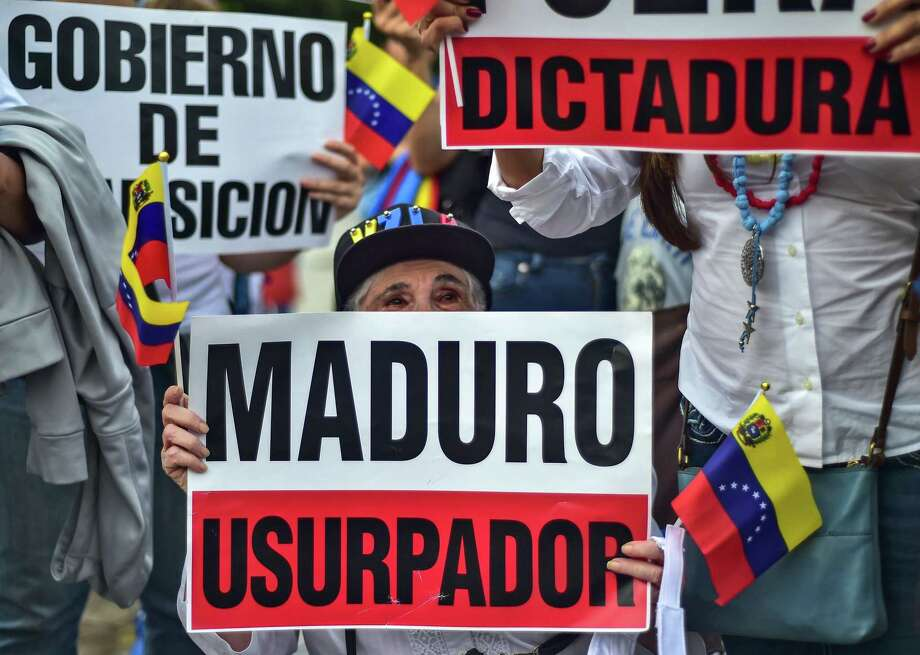 Venezuelan citizens demonstrate against Venezuelan President Nicolas Maduro in Panama City on April 30, 2019. - Venezuelan opposition chief Juan Guaido declared himself acting president in January 2019 and claimed on April 30 to have also secured the backing of Venezuelan soldiers, while the country's leftist government said an attempted coup was under way. (Photo by Luis ACOSTA / AFP)LUIS ACOSTA/AFP/Getty Images Photo: LUIS ACOSTA, Contributor / AFP/Getty Images / AFP or licensors