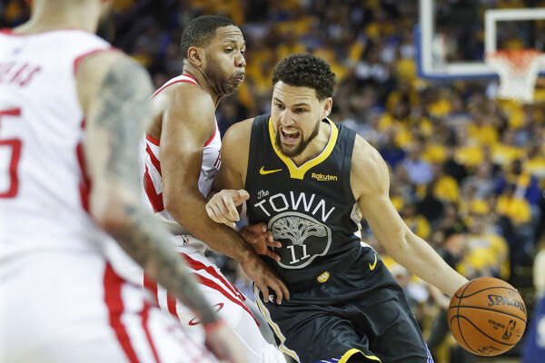 187b14f0b8399 1of8Golden State Warriors Klay Thompson drives against Houston Rockets Eric  Gordon in the second quarter during game 2 of the Western Conference  Semifinals ...