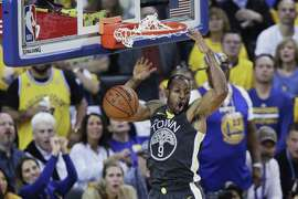 Golden State Warriors Andre Iguodala dunks in the second quarter during game 2 of the Western Conference Semifinals between the Golden State Warriors and the Houston Rockets at Oracle Arena on Tuesday, April 30, 2019 in Oakland, Calif.