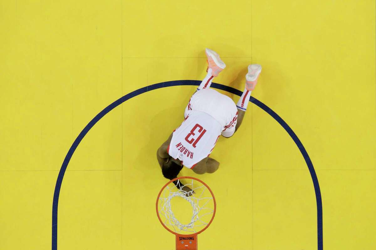Houston Rockets guard James Harden (13) is down on the court after being hit in the face in the first half by Golden State Warriors forward Draymond Green (23) in Game 2 of the NBA Western Conference Semifinals on Tuesday, April 30, 2019 at Oracle Arena. Golden State Warriors won the game 115-109.