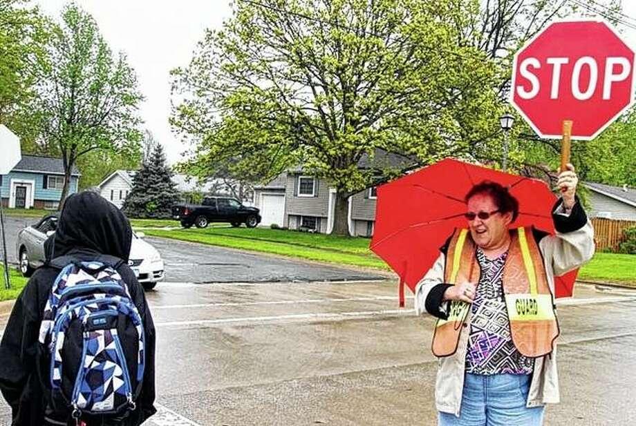 Carol Wallbaum of Jacksonville stops traffic Tuesday on West Lafayette Avenue near Eisenhower Elementary School to let students cross the road. Photo: Samantha McDaniel-Ogletree | Journal-Courier
