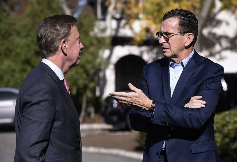 Former Connecticut Gov. Dannel P. Malloy, right, in November 2018 alongside current Gov. Ned Lamont in Hartford, Conn. (AP Photo/Jessica Hill) Photo: Jessica Hill / Associated Press / Copyright 2018 The Associated Press. All rights reserved