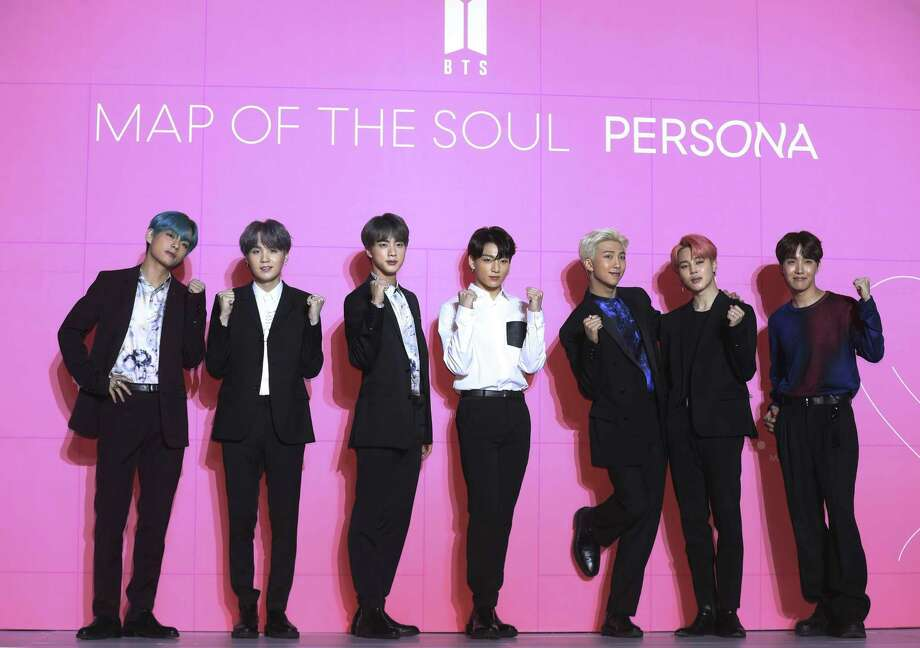 """Members of South Korean K-Pop group BTS pose for photos during a press conference to introduce their new album """"Map of the Soul: Persona"""" in Seoul, South Korea, Wednesday, April 17, 2019. Photo: Jo Soo-jung, SUB / Associated Press / Newsis"""