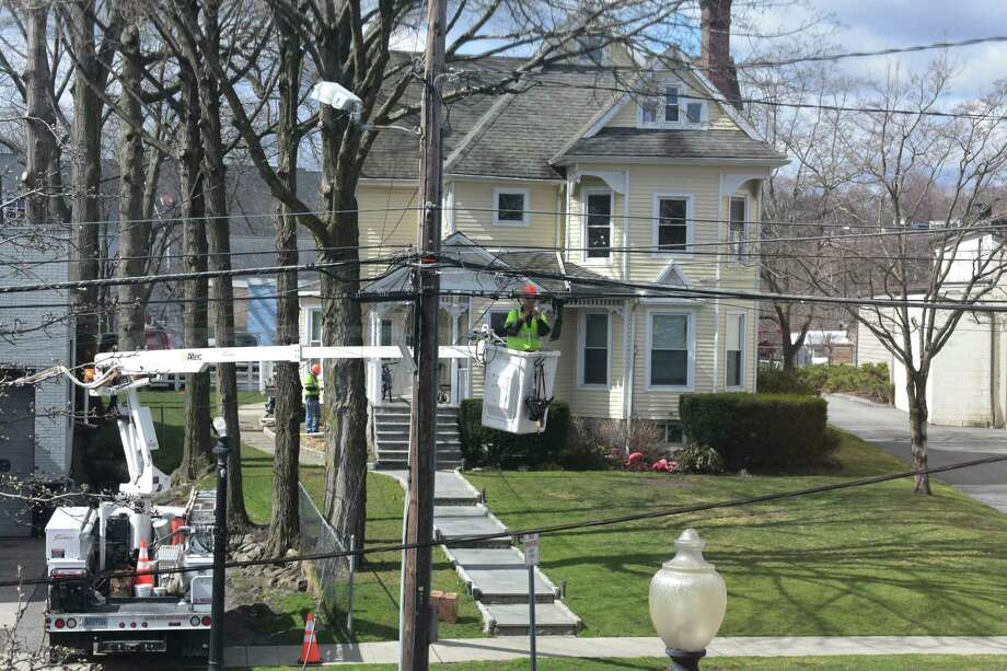 A Frontier Communications line crew at work in mid-April 2019 in Danbury, Conn. Photo: Alexander Soule / Hearst Connecticut Media / Stamford Advocate