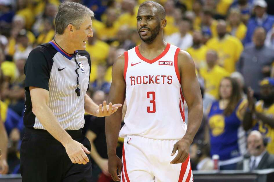 Houston Rockets guard Chris Paul (3) talks to Scott Foster during game 2 of the NBA Western conference semifinals against the Golden State Warriors at Oracle Arena on Tuesday, April 30, 2019.