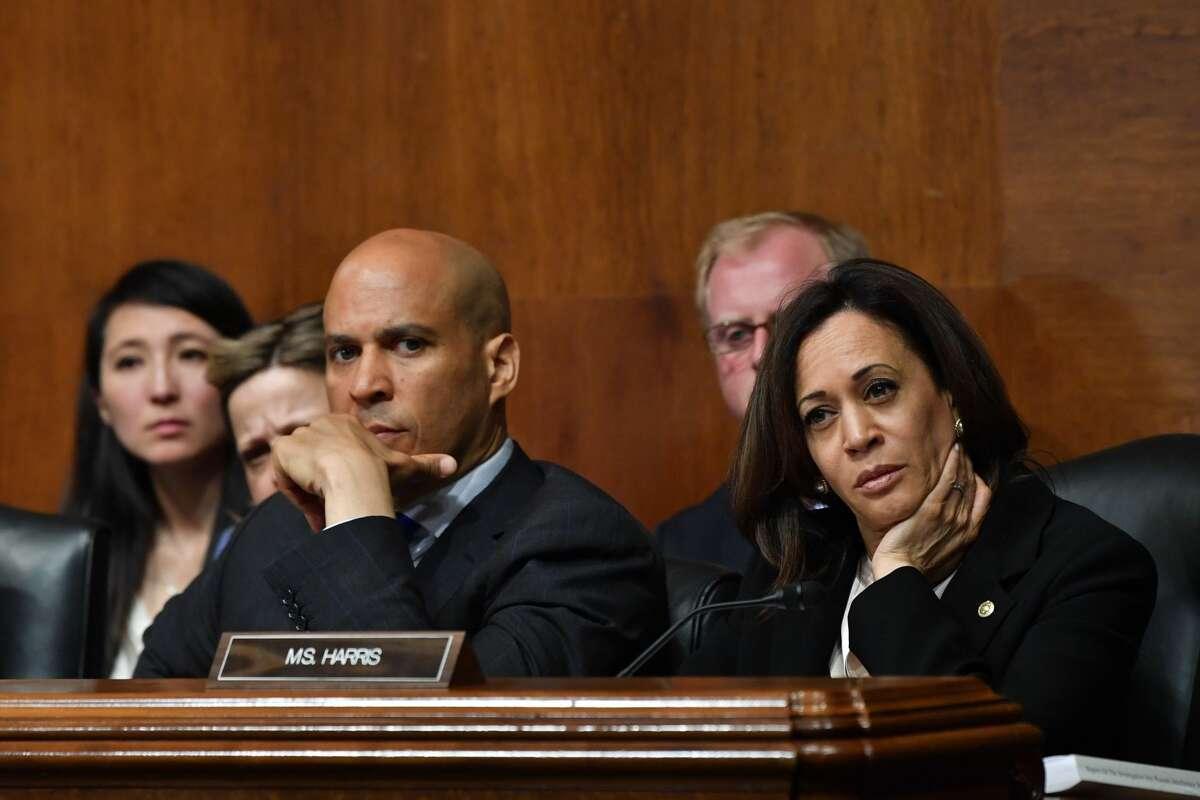 US Senators Cory Booker (L) and Kamala Harris listen as US Attorney General William Barr testifies before the Senate Judiciary Committee on