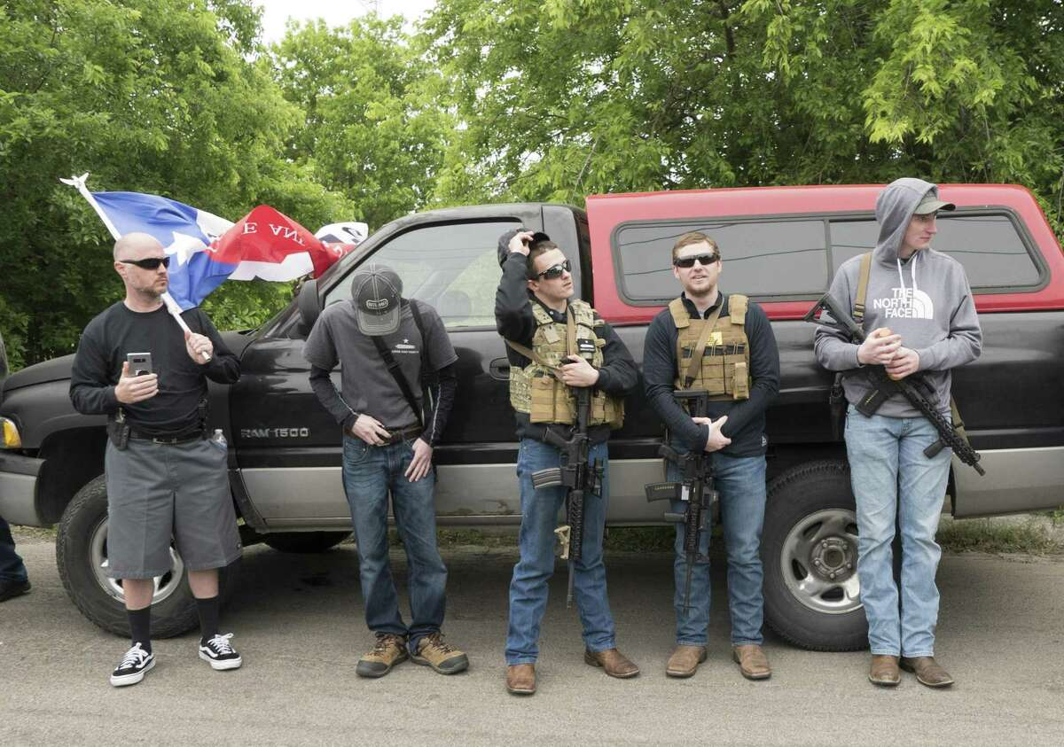 Members and supporters of Open Carry Texas prepare to march on Olmos Park on Saturday, April 7, 2018. They were demanding that police chief Rene Valenciano lose his job over what they say is unfair treatment of their members.