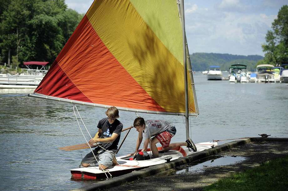 Dan Reilly, 18, left, and Justin Halmose, 17, of Newtown, prepare to launch their sunfish from Lattins Cove in Danbury for a sail on Candlewood Lake Thursday, August 9, 2018. Photo: Carol Kaliff / Hearst Connecticut Media / The News-Times