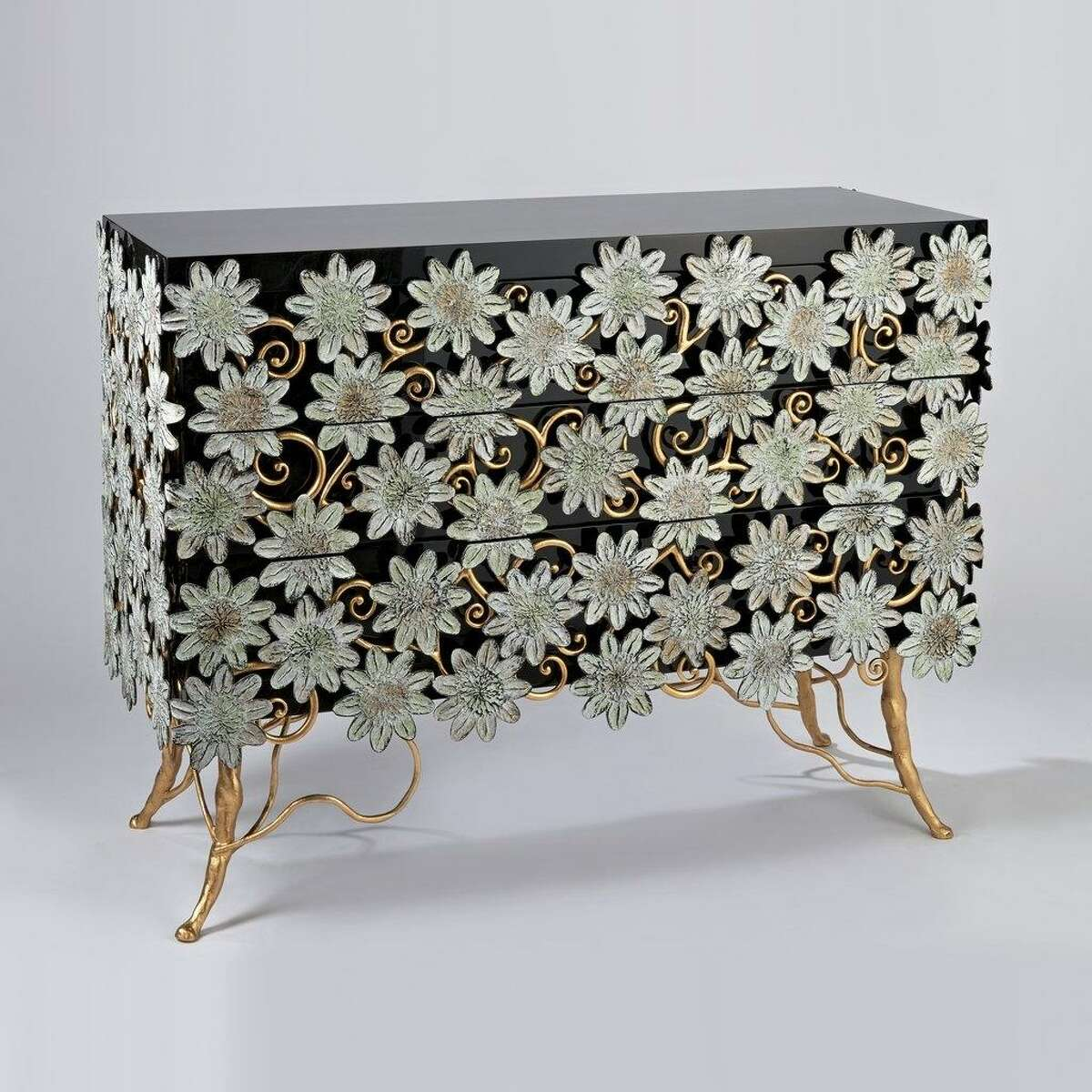 Functional art: It's hard to call this work by artist Le Gall Hubert a dresser, with hits gorgeous ebony finish, gold leaf and hand-painted bronze flowers. $x,xxx; 21stgallery.com