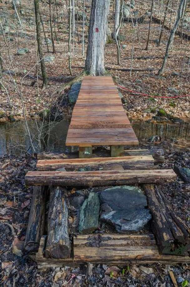 Last winter, Tommy Candelora and Zachary Abbagnaro, both of North Branford Boy Scout Troop 453, designed, built and installed two cedar and plank bridges on North Branford Land Conservation Trust's (NBLCT) Notch Hill Brook Trail. Photo: Contributed Photo / Ulrich Flemming