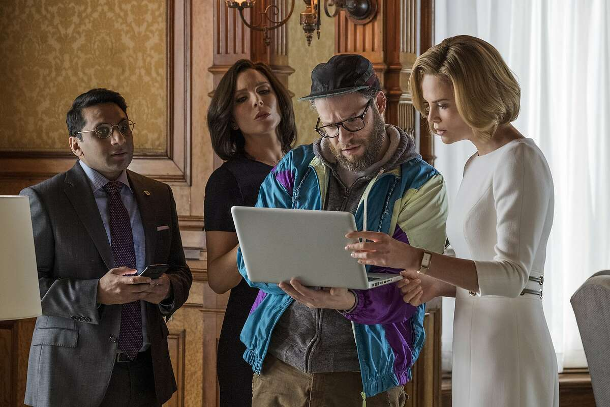 """This image released by Lionsgate shows Ravi Patel, from left, June Diane Raphael, Seth Rogen and Charlize Theron in a scene from """"Long Shot."""" (Philippe Bossé/Lionsgate via AP)"""