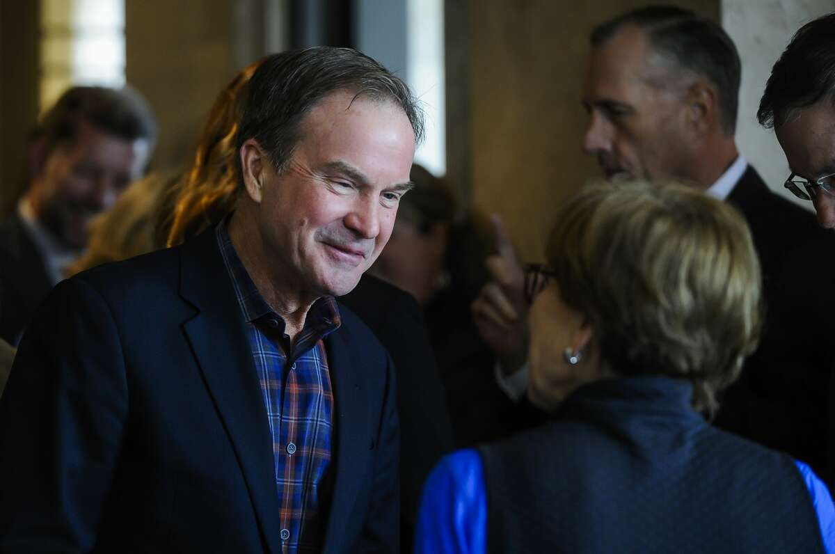 Rollin M. Gerstacker Foundation Vice President Bill Schuette chats with Midland Mayor Maureen Donker before a celebration of Midland's downtown streetscape on Tuesday, April 30, 2019 at The H Hotel. (Katy Kildee/kkildee@mdn.net)