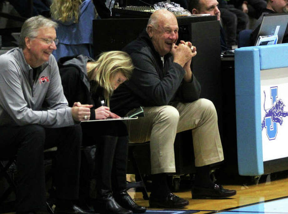 Former Edwardsville High School basketball coach Bud Vallino, right, jokes around with an official while helping out Triad. Vallino will be inducted into the IBCA Hall of Fame on Saturday in Normal.