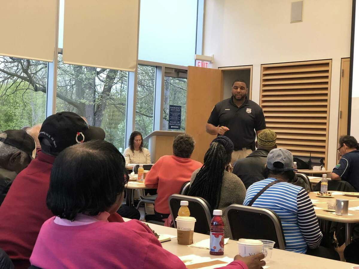 Yale police Officer Martin Parker and Assistant Chief Steven Woznyk spoke as part of a community breakfast Wednesday in New Haven.