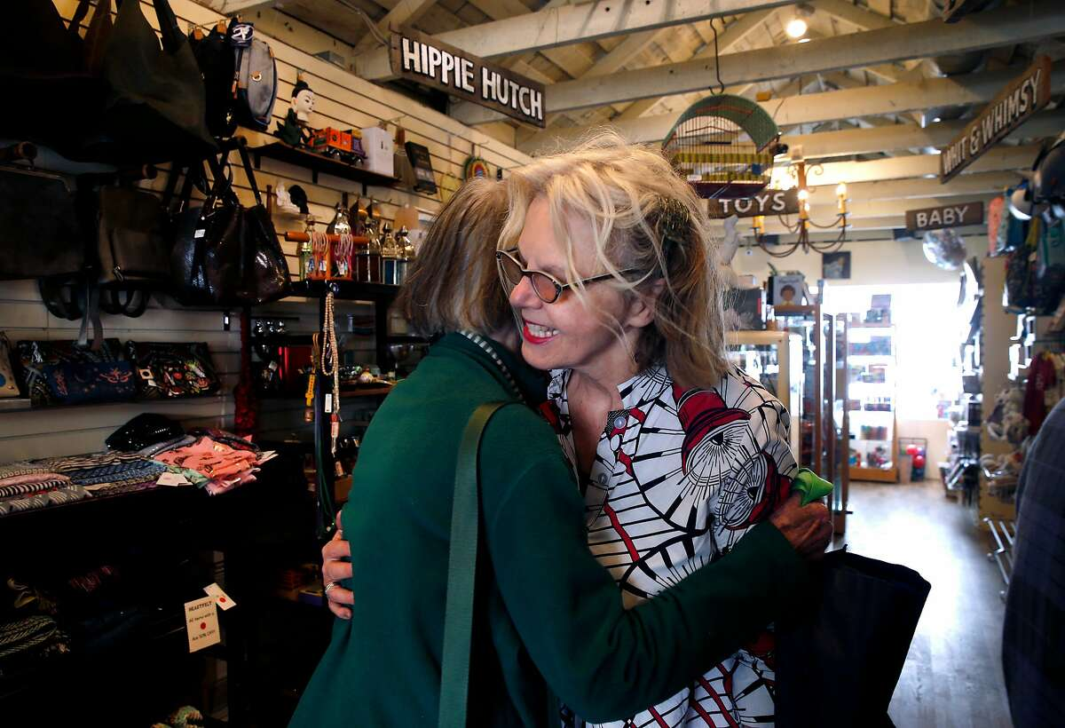 Heartfelt store owner Darcy Lee (right) hugs longtime customer Lindsay Kefauver in San Francisco, Calif. on Tuesday, April 30, 2019. The gift shop on Cortland Avenue in Bernal Heights is closing after 25 years in business later this summer.