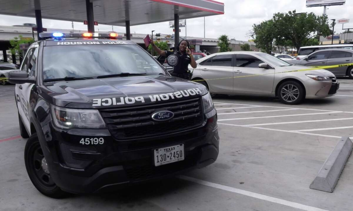 Houston police officers investigate a shooting that injured a small child at a southwest Houston gas station on Wednesday, May 1, 2019.