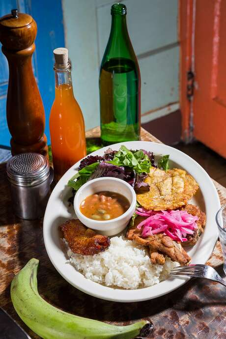 A plate of fried pork, plantains, tostones, rice and beans, and salad at Sol Food Restaurant in San Rafael, Calif., Tuesday May 19, 2015.