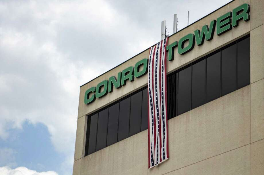 A banner hangs from the side of Conroe Tower during a Loyalty Day proclamation reading Wednesday, May 1, 2019 at the Montgomery County War Memorial Park in Conroe. Photo: Cody Bahn, Houston Chronicle / Staff Photographer / © 2018 Houston Chronicle