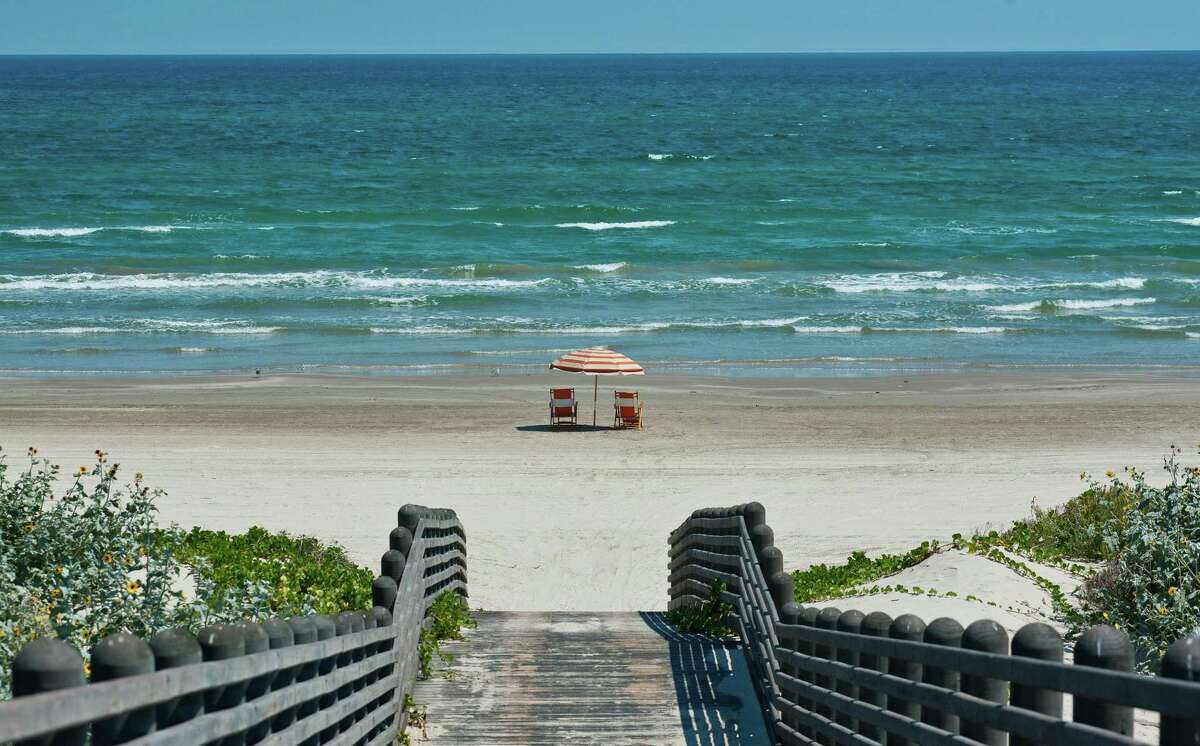 A serene stretch of sand over the boardwalk at Cinnamon Shore on Mustang Island