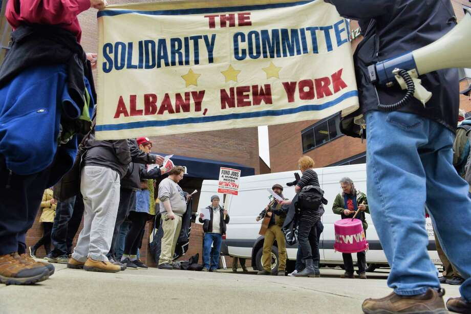 Members of labor organizing groups and supporters of unions, take part in a walking tour around Albany in honor of May Day on Wednesday, May 1, 2019, in Albany, N.Y. The tour explored the radical history of the Capital Region.  (Paul Buckowski/Times Union) Photo: Paul Buckowski, Albany Times Union / (Paul Buckowski/Times Union)