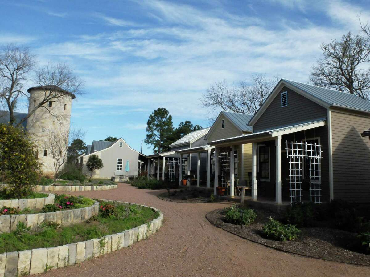 Cottages at the Fredericksburg Herb Farm looked cozy before trees had budded out early this spring.