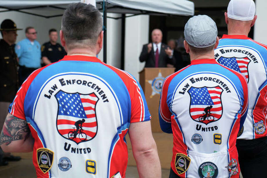 A total of 26 Law Enforcement United riders from all over the country left St. Louis on Wednesday and are pedaling 1,300 miles to Washington D.C. Madison County Sheriff's Department held a ceremony to honor fallen officers and to celebrate the riders. Photo: Breanna Booker | The Intelligencer