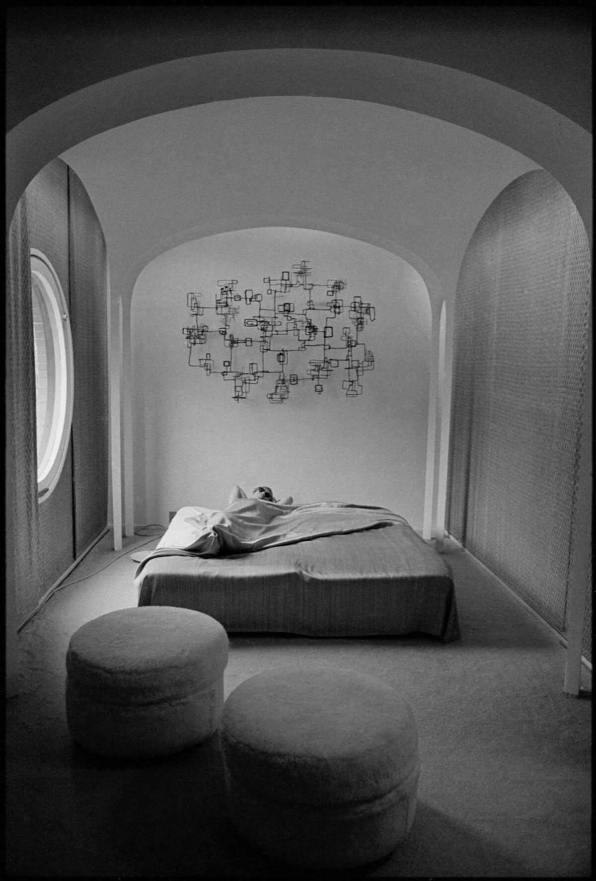 Andy Warhol rests in the guest house of Philip Johnson's Glass House in New Canaan in the winter of 1964-65.