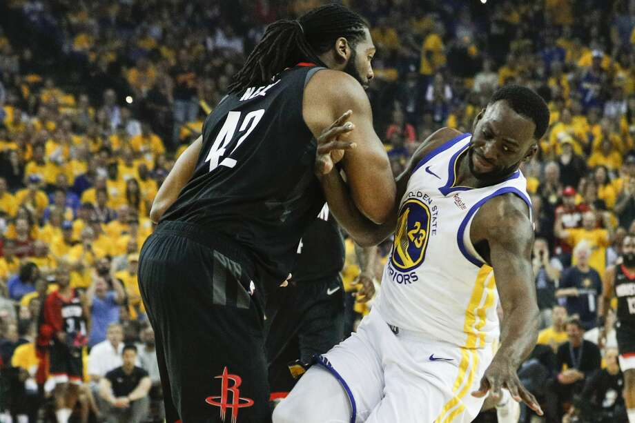 Nenê and Draymond Green, seen here tangling in Game 1, were handed double technical fouls during Tuesday's Game 2 but those have been rescinded by the NBA. Photo: Carlos Avila Gonzalez/The Chronicle