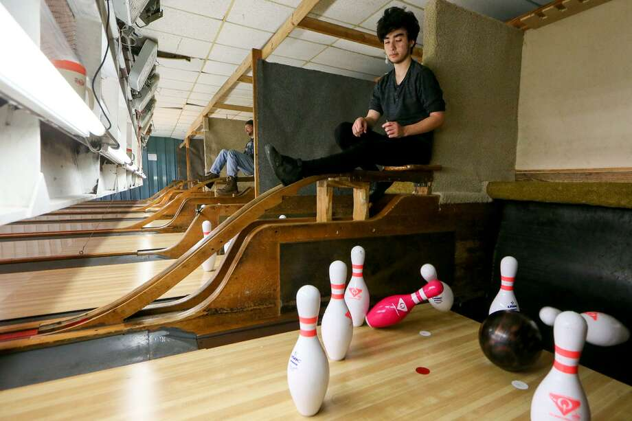Pinsetter Brandon Cantwell, 16, watches the action below him during league night at the Cibolo Bowling Club, 519 N. Main St. in Cibolo, on April 23. The pins are reset and balls are returned by pinsetters in 9-pin bowling. Photo: Marvin Pfeiffer /Staff Photographer / Express-News 2019