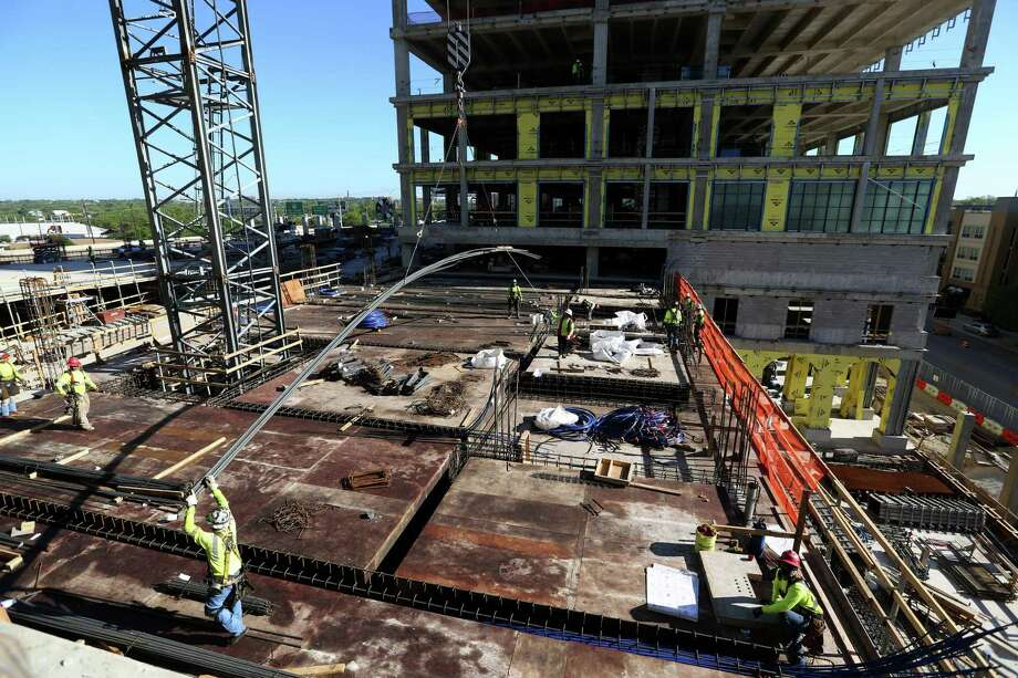 Rebar is moved into position by a crane on the future home of the Credit Human headquarters. Photo: William Luther /Staff Photographer / ©2019 San Antonio Express-News