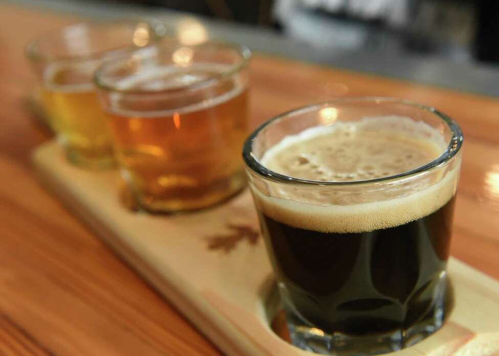 A flight of beer is seen on a bar as Congressman Paul Tonko takes a tour of the Frog Alley Brewing at the Mill Artisan District construction project on Friday, Feb. 22, 2019 in Schenectady, N.Y. (Lori Van Buren/Times Union)